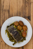 Fish with potato and vegetables on white plate Royalty Free Stock Photo