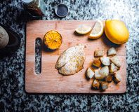 Fish and potatoes on cutting board