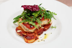 Fish and potatoes fried with romesco sauce Stock Photo