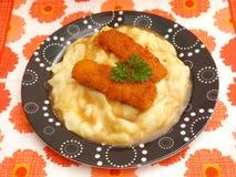 Fish and potatoes Stock Photos