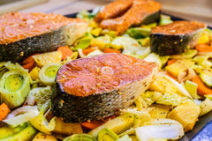 Fish with potatoes and vegetables Stock Photo