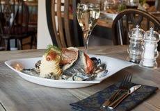 Fish and prawns with mashed potatos Royalty Free Stock Photo