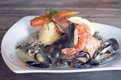 Fish and prawns with mashed potatos Royalty Free Stock Images