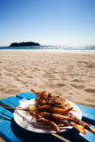 Fish and prawns by a tropical beach Stock Photo