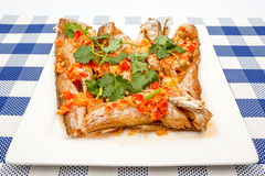 Fish prepared at Thai. Prepared fish with red peppers and some coriander leaves Royalty Free Stock Photography
