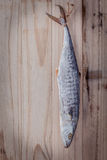 Fish preservation by drying . Barracuda salted hanging on old wo Royalty Free Stock Photo