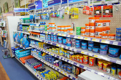 Fish products and aquariums. London, England – Circa July 2014: Tropical and cold water fish and products for sale in a pet supermarket in England stock image