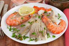 Fish ray with seafood, capers and lemon Stock Photos