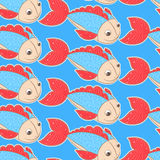 Fish with red fins. Seamless pattern. fish with red fins on a blue background Stock Photography