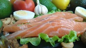 Fish red, pour lemon, kiwi, tomato, garlic. Fish red, pour lemon kiwi tomato garlicn stock video footage
