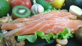 Fish red recipe , pour lemon, kiwi, tomato, garlic. Fish red, pour lemon kiwi tomato garlicn recipe stock video footage