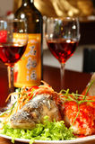 Fish with red wine. Prepared fish with red wine on a table at restaurant Stock Image