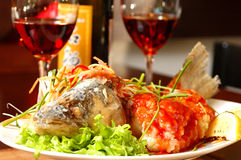 Fish with red wine. Prepared fish with red wine on a table at restaurant Royalty Free Stock Photo