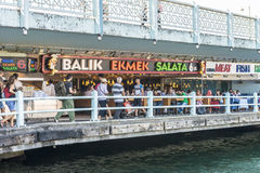 Fish restaurants on the Galata Bridge street cafe in Istambul Royalty Free Stock Photo