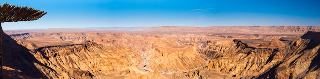 Fish River Canyon in Namibia panorama view. Fish River Canyon, aka Visrivier Canyon or Visrivier Afgronde, in southern Namibia - the largest canyon in Africa Stock Image
