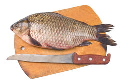 Fish a river crucian. Today there will be a fish dish from a river crucian Stock Photo