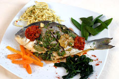 Fish roast. A fish roast on a table royalty free stock photo