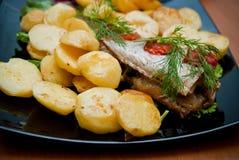 Fish and roasted potato Royalty Free Stock Photography