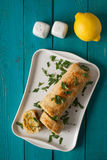 Fish roll with greens and carrots on the cyan table top view Stock Image