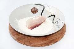 The fish rolled in flour and prepared for frying Stock Photography
