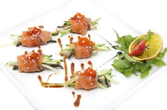 Fish rolls with herbs and fruit Stock Photos