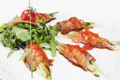 Fish rolls with herbs and fruit Stock Images