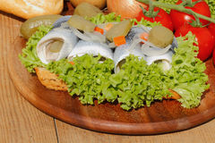 Fish rolls with sour herring, pickled herring Stock Images
