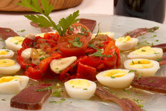 Fish salad. Cold salad with dried fish and quail eggs Stock Images