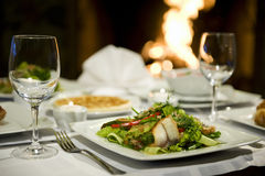 Fish salad. With greens and glasses Royalty Free Stock Image