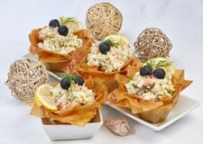 Fish salad with a crispy side pasta sheets royalty free stock image