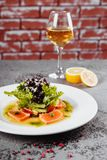 Fish salad with glass of wine. royalty free stock image