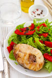 Fish with salad on plate Stock Photography