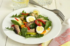 Fish salad with quail eggs, sweet peppers, herbs Stock Images