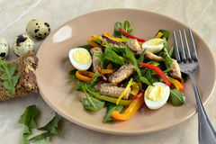Fish salad with quail eggs, sweet peppers, herbs Royalty Free Stock Photo