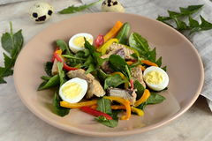 Fish salad with quail eggs, sweet peppers, herbs Royalty Free Stock Image
