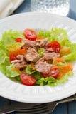 Fish salad on white plate Stock Photo