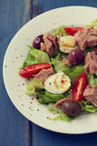 Fish salad on white plate Royalty Free Stock Photo