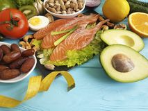 Fish salmon date salad health lemon nourishment centimeter omega 3 avocado on blue wooden background healthy food royalty free stock photos
