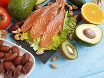Fish salmon salad health nourishment omega 3 avocado on blue wooden background healthy food. Fish salmon avocado blue wooden background healthy food omega 3 Royalty Free Stock Photo