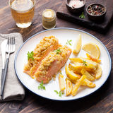 Fish salmon with crumple on top with baked potatoes and lemon slices Royalty Free Stock Images