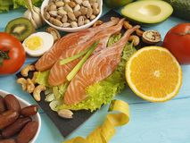 Fish salmon date salad health vitamin pistachio trout stock image