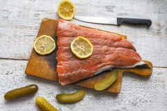 Fish salmon raw slice cutting board eating food Stock Photography