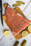 Fish salmon raw slice cutting board eating food Stock Photos