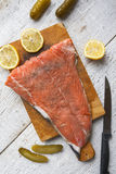 Fish salmon raw slice cutting board eating food Royalty Free Stock Photos