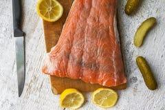 Fish salmon raw slice cutting board eating food royalty free stock photography