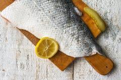 Fish salmon raw slice cutting board eating food Royalty Free Stock Photo