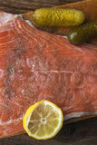 Fish salmon raw slice cutting board eating food royalty free stock images