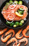 Fish salmon and shrimp with greens, lime and vegetables in a rus. Tic style Royalty Free Stock Photo