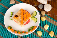 Fish sandwich. A fish shaped sandwich, healthy kid food royalty free stock image