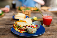Fish sandwich. Delicious fresh fish sandwich and green salad served for lunch Stock Images